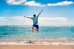 Travel and Vacation concept. Happy young man having fun outdoors. Joyful man. Summer. Holidays